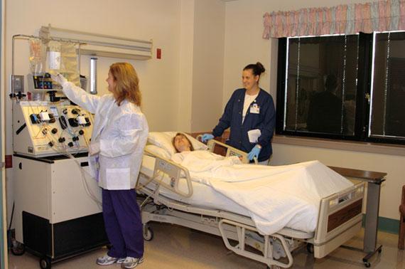 Stacey Walsh, R.N. (left), apheresis nurse, and Erin Staffileno, apheresis technician